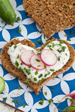 Whole wheat bread with cream cheese and vegetables photo