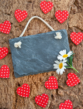 Little slate board on rustic background made from bark Stock Photo