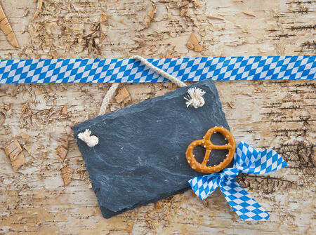 Rustic background with bavarian white and blue ribbon