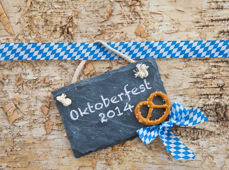 Rustic background with bavarian white and blue ribbon photo