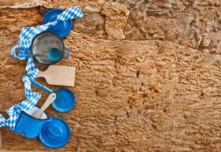 Little pots and pans on rustic wooden background