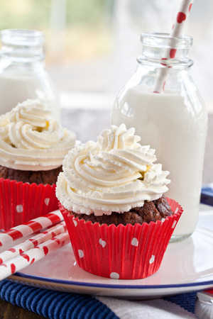 Little chocolate cupcake with vanilla cream cheese frosting photo