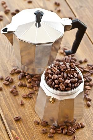 Vintage Moka pot and fresh roasted coffee beans photo