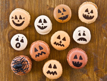 funny faces: Macaroons with scary and funny faces for Halloween Stock Photo
