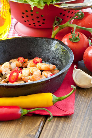 cast iron pan: Garlic shrimps with chili peppers in cast iron pan