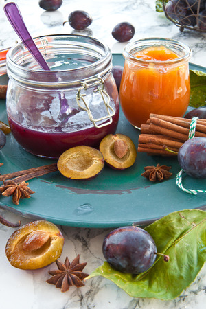 winterly: Variety of homemade plum jams with winterly spices