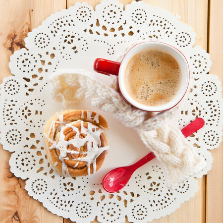 Fresh homemade cinnamon roll and a cup of coffee photo