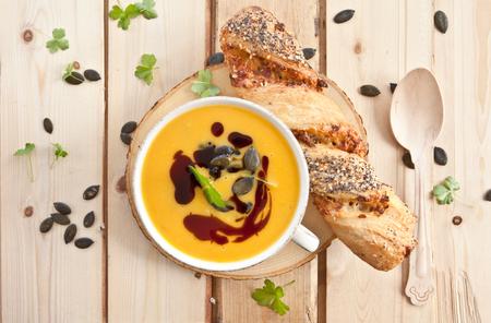 Homemade pumpkin soup with pumpkin seeds and pumpkin seed oil photo