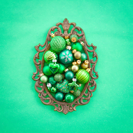 shiny christmas baubles: Green christmas baubles in a vintage frame Stock Photo