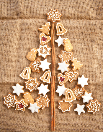Homemade christmas cookies on a background made of burlap photo