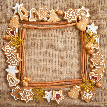 Homemade christmas cookies on a background made of burlap