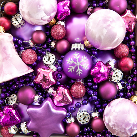 Purple background made from various christmas ornaments
