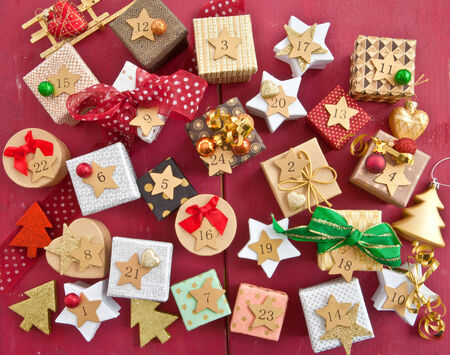 Little colorful presents with ribbons and christmas decorations photo