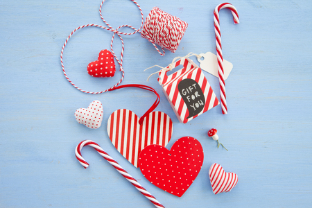 strips away: Little gift and decorations for christmas on blue Stock Photo