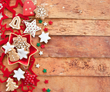 Christmas cookies and decorations won rustic wooden background photo