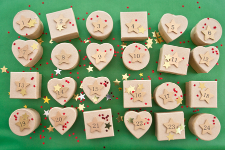 git: Little git boxes with decoration for christmas on green Stock Photo