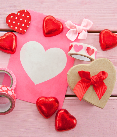 gift wrapping: Chocolate hearts and colorful gift wrapping material