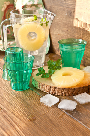 mint leaves: Homemade lemonade with pineapple and fresh mint leaves