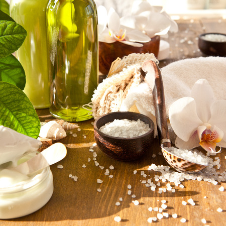 bath salts: Bath salts and other skin care products  with fresh orchids Stock Photo