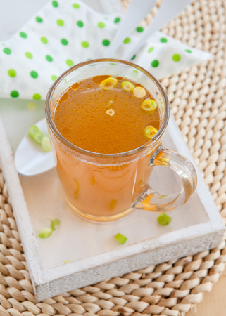 Homemade bone broth with leek in glass cup Banque d'images