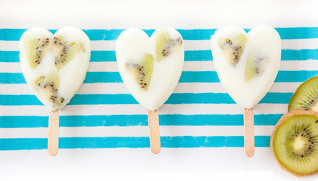 Homemade frozen popsicles with yogurt and fresh fruits