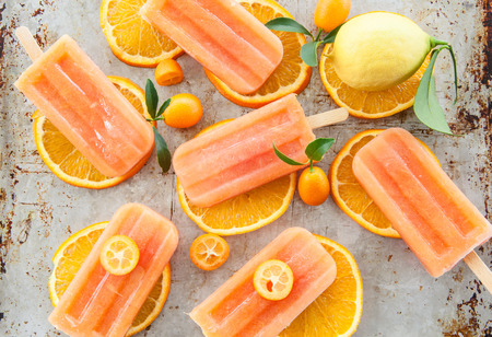 Homemade frozen popsicles made with oragnic fresh oranges Stock Photo