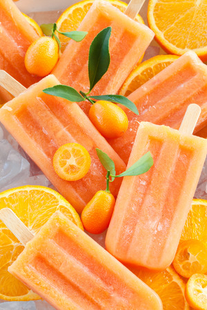 fresh cream: Homemade frozen popsicles made with oragnic fresh oranges Stock Photo