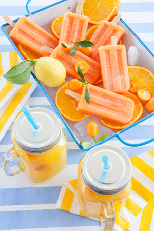 popsicles: Homemade frozen popsicles made with oragnic fresh oranges Stock Photo