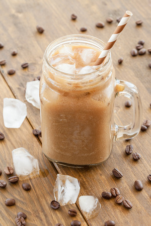 bens: Iced coffee with milk in vintage jar Stock Photo