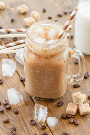 iced coffee: Iced coffee with milk in vintage jar Stock Photo