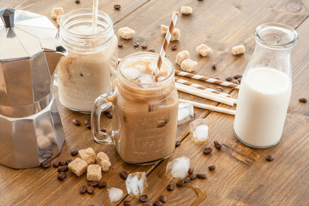 Iced coffee with milk in vintage jar Stock Photo