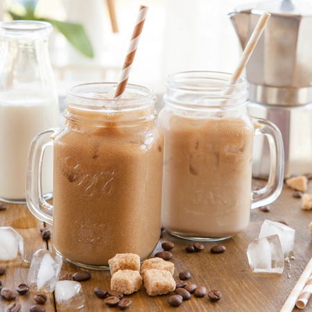 ice cold: Iced coffee with milk in vintage jar Stock Photo