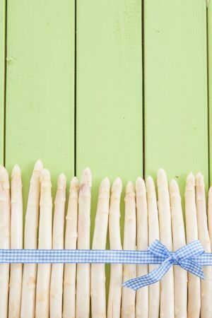 white asparagus: Fresh white asparagus on rustic wooden boards