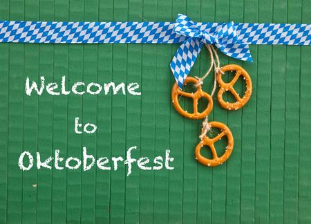 beerfest: Little pretzels on green painted wooden background