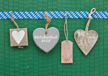 beerfest: Little heart-shaped tags on green wooden background Stock Photo