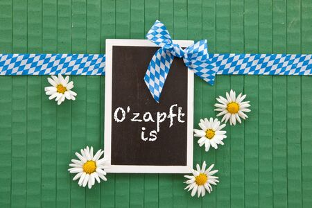 beerfest: Little chalkboard on green painted wooden background with daisies