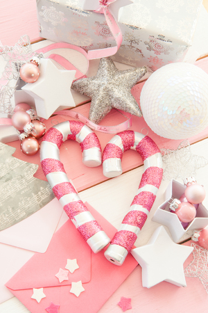 pink christmas decorations with glittery ornaments on striped wooden background stock photo 42549985 - Pink Christmas Decorations