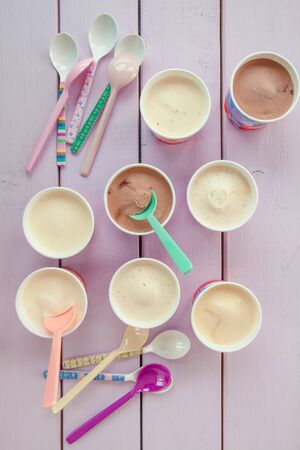 small paper: Various ice creams in small paper cups on purple