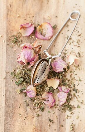 pink rose petals: Green tea with pink rose petals with vintage tea spoon