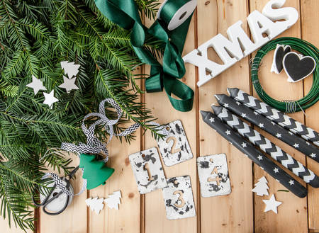crafting: Materials for crafting and advent garland with holly and pine branches