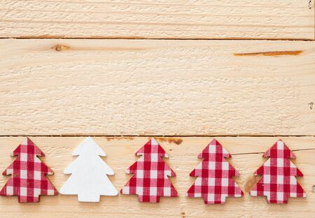 Rustic christmas background with red plaid christmas tree