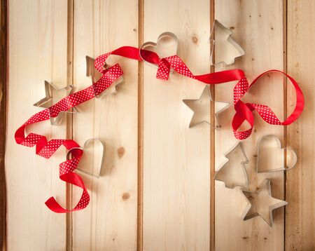 cookie cutters: Various christmas cookie cutters on rustic wooden background Stock Photo
