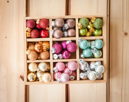red glittery: Colorful christmas baubles on rustic wooden background Stock Photo