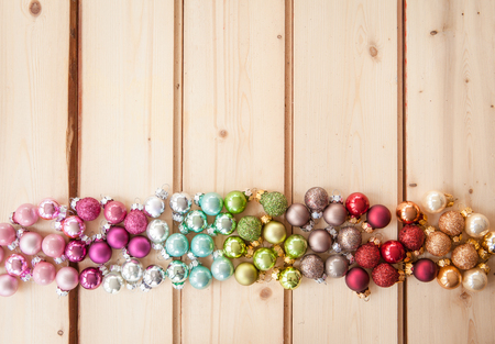 christmas baubles: Colorful christmas baubles on rustic wooden background Stock Photo