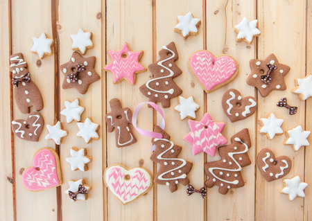 Variety of christmas cookies on rustic wooden background