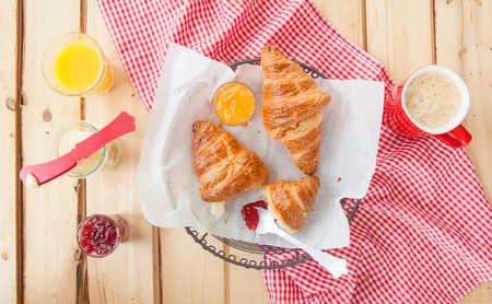 oj: Fresh French croissants with jam for breakfast Stock Photo