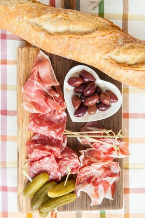 jamones: Selection of hams and salami on vintage wooden cutting board