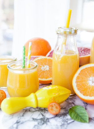 Fresh pressed juice from colorful citrus fruits