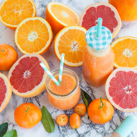 oj: Fresh pressed juice from colorful citrus fruits
