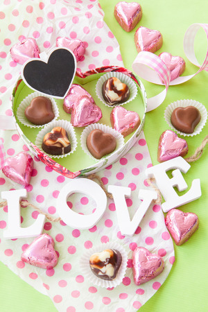 mothersday: Colorful Chocolates in heart shaped chocolate box Stock Photo